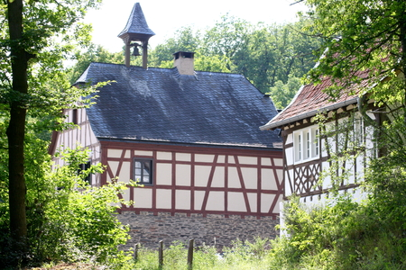 An old beautiful renovated half-timbered House, with trees in the background Stock Photo - 29303391