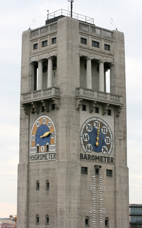 barometer: A large tower with hygrometer and barometer hands Stock Photo