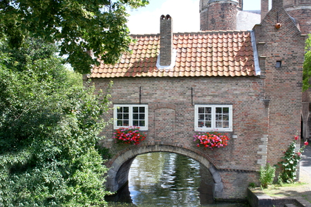 transom: Romantic house with archway over a watercourse