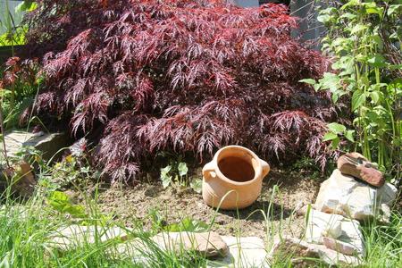 greek pottery: A terracotta amphora lying in green grass
