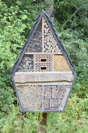 wintering: A small insect hotel with a pointed roof