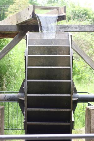 waterwheel: The wooden waterwheel in a historic Mill
