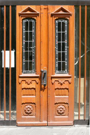 doorhandle: Front door with stained glass and wooden ornaments