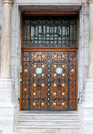 doorhandle: Front door with metal ornaments and wood ornaments Stock Photo