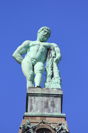 Hercules statue with blue sky in the background Archivio Fotografico