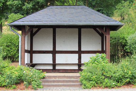 slate roof: A bus shelters with half-timbered and slate roof Stock Photo