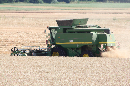 Germany July 22, 2015: farmer at harvest Editorial