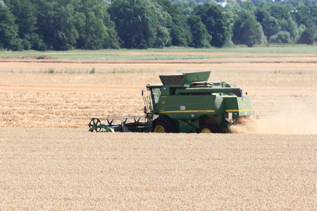 harvesters: Germany July 22, 2015: farmer at harvest Editorial