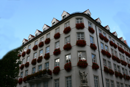 Multi-storey with flowers on each window