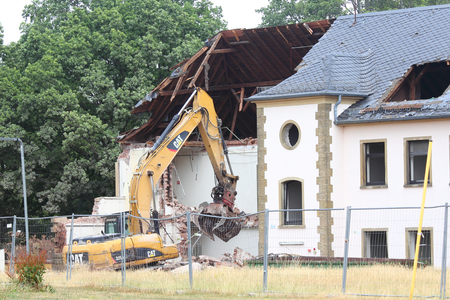 Germany July 20, 2015: An excavator demolition
