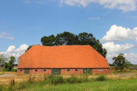 Big agricultural building, blue sky in background Zdjęcie Seryjne