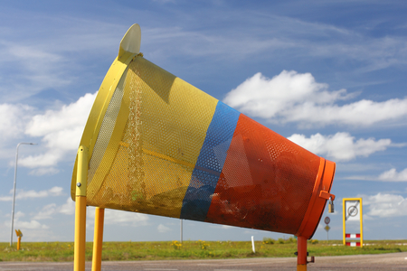 A colorful rubbish containers for cyclists, with blue sky in the background