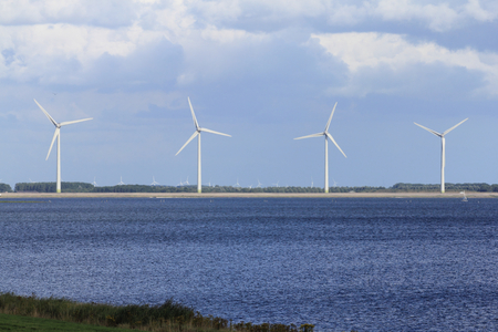 Several windmills, blue sky in the background Stock Photo
