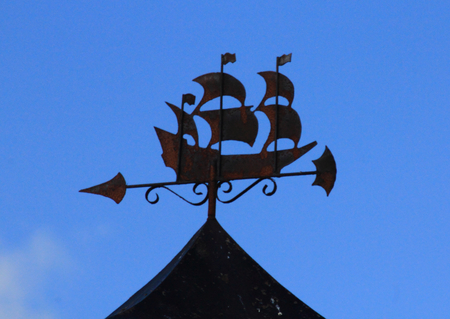 Beautiful ornate chimney hood, with blue sky in the background