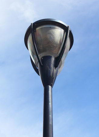 A street lamp, with blue sky in the background