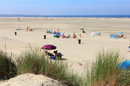 The Netherlands August 22, 2015: Beach on the North Sea Netherlands August 22, 2015: The sand beach at the North Sea
