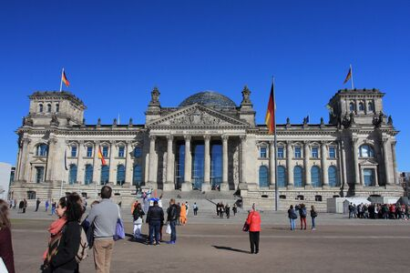 Berlin, Germany April 6, 2018: The Reichstag officially: Deutscher Bundestag – Plenarbereich Reichstagsgebäude pronounced is a historic edifice in Berlin, Germany, constructed to house the Imperial Diet