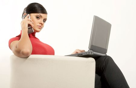 Atractive brunet businesswoman sitting with Laptop and phone on the white chair Stock Photo - 2171070
