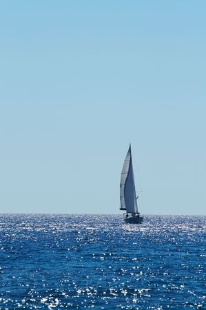 maneuvering: The large, beautiful yacht in the light-blue sea. A fresh wind and pleasant movement