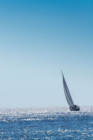 mediterraneo: The large, beautiful yacht in the light-blue sea. A fresh wind and pleasant movement