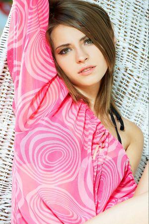 Summer girl wearing a nice pink dress