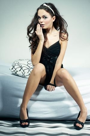 Sexy Woman Sitting on Bed with Pillow Stock Photo - 3208557