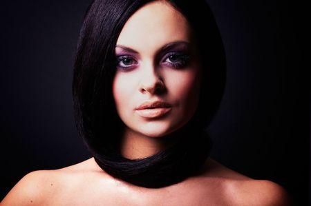 bobbed: Fashion girl posing on dark background - portrait