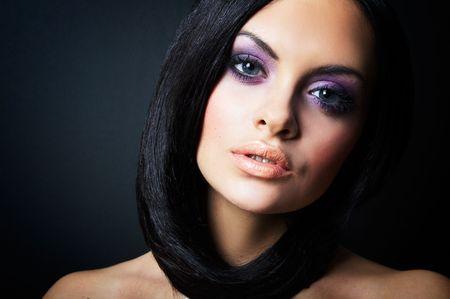hair blacks: Fashion girl posing on dark background - portrait