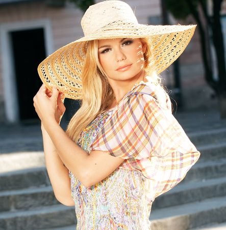 sun hat: Young Blond Woman Wearing Sun Hat