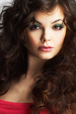 Portrait of sexy woman with beautiful make-up and long curly hair photo