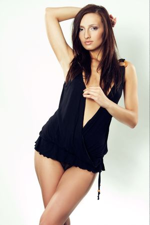 tall brunet in black tunic over white Stock Photo - 3560670