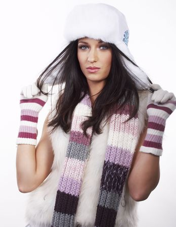 beautiful brunette with hat, gloves, shawl posing on white background photo