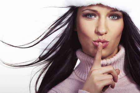 beautiful brunette with hat, gloves, shawl posing on white background photo