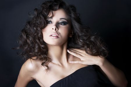 beautiful brunette posing on black background in studio.  Stock Photo