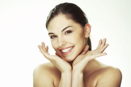 A happy young woman with facial expression on white background Stock Photo