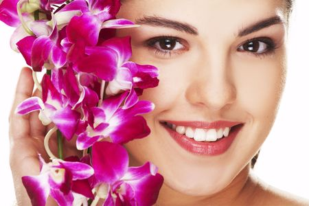 headcloth: happy young woman with orchid on white background Stock Photo