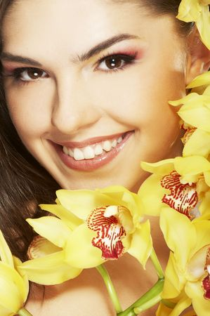 happy young woman with orchid on white background Stock Photo