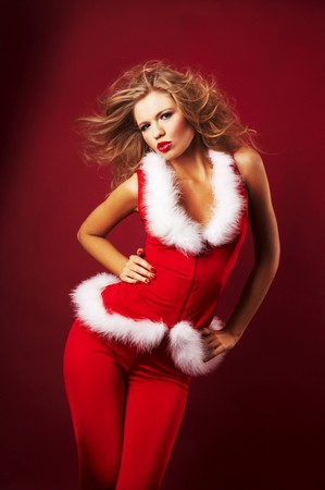 Portrait of beautiful sexy girl wearing santa claus clothes on red background Stock Photo - 3969866