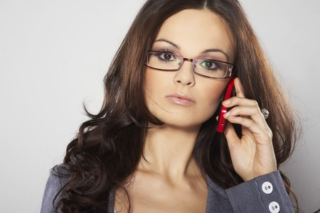 Attractive businesswoman with cell phone and eye glasses  Stock Photo