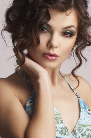 Portrait of sexy woman with beautiful make-up and curly hair  photo
