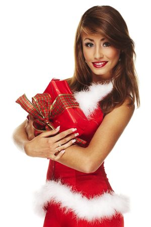 Portrait of a smiling young christmas woman giving a gift  Stock Photo - 5402985