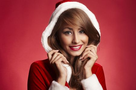 Closeup of a cute Santa lady on red background photo