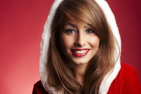 beautiful woman wearing fur hood on red background photo