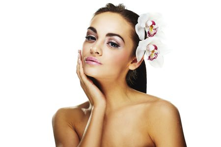 Sexy young woman with flowers - Beautiful portrait of a  sexy woman with bright white flowers. photo