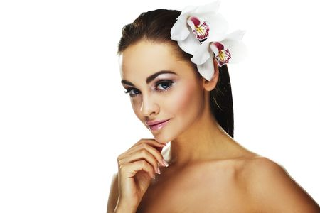 Sexy young woman with flowers - Beautiful portrait of a  sexy woman with bright white flowers. Stock Photo - 5638463