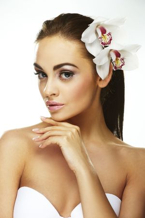 Sexy young woman with flowers - Beautiful portrait of a  sexy woman with bright white flowers. Stock Photo - 5638462