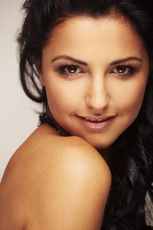 Close-up portrait of a beautiful brunett model in studio on light background photo