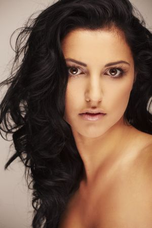 Close-up portrait of a beautiful brunett model in studio on light background Stock Photo - 5644618