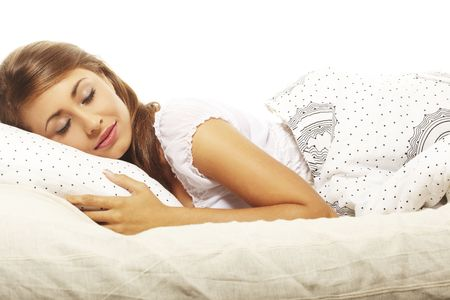 waking: Sweet woman lying in bed  Stock Photo