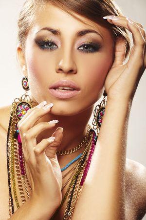 fashion woman with jewelry on light bacground photo